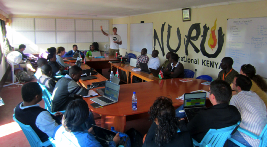 CEO Jake Harriman holding a lessons learned session with Nuru Kenya staff.