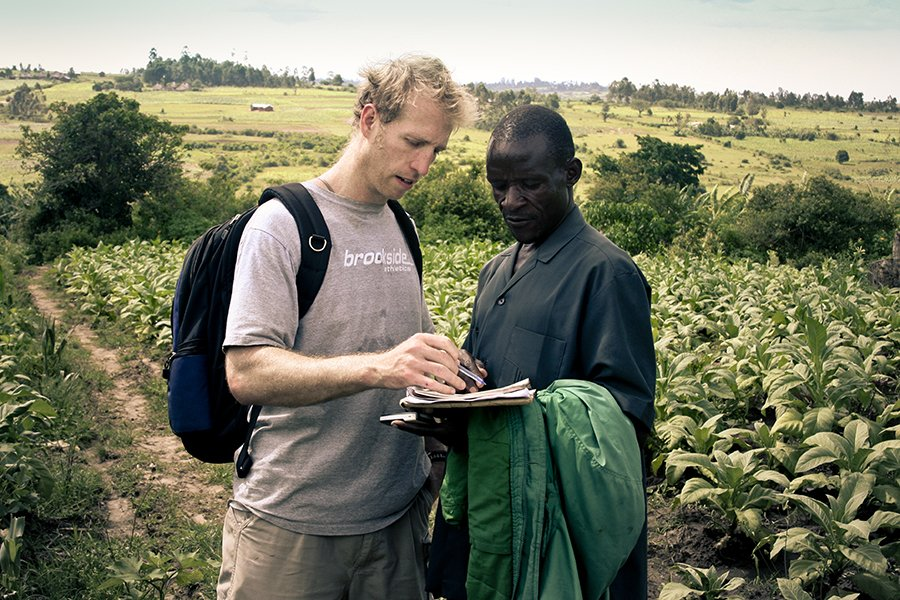 Jake Harriman talking with Agriculture Program Field Manager James Magaigwa Chacha in Kenya