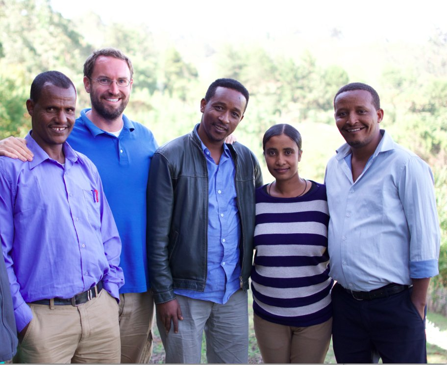 """People in the education field often get caught up in technology. But when you go into a school with no electricity, no books and dirt floors, you realize maybe the best option isn't giving every kid a laptop,"" says Jimmy Leak '12 (second from left), flanked by Nuru Ethiopia team members. Courtesy of Jimmy Leak."