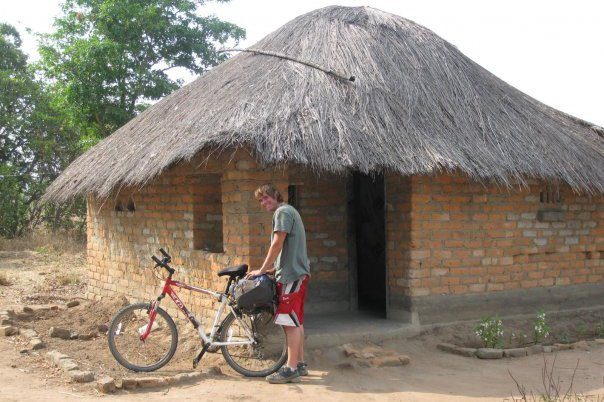 Casey arriving back to his house in Peace Corps after a long bike ride