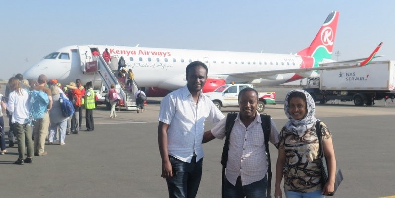 Yonas Arega, Feven Yimer, and Zelalem Abera board a Kenya Airways flight on their way to Isibania, Kenya