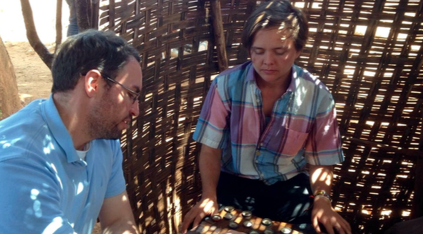 immy (Nuru Education PSA) and Becca in a serious game of checkers (dama) at the local bunna bet (coffee place).