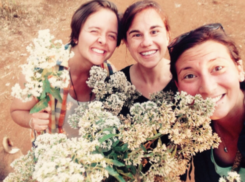 Members of the Field Team picking fresh flowers on a weekend hike in Zefine, Ethiopia.