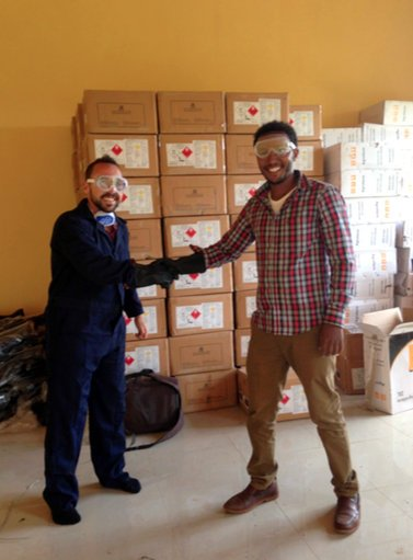 David Resetar, Rural Livelihoods and Leadership Program Specialist, and Mekonnen Mestu Aba, Hidota Union Manager displaying the use of proper safety equipment when controlling FAW