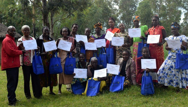 "#HealthforAll ""No more preventable diseases and deaths for farmers in my community."" Nuru Kenya farmer co-operative health volunteer leaders displaying their certificates after successful completion of their initial healthcare training."