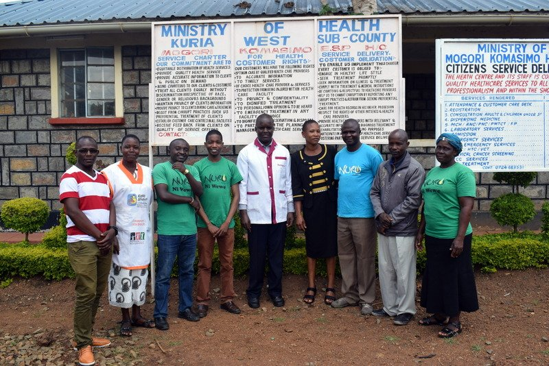 Nuru Kenya Healthcare team and Mogori Komasimo healthcare workers posing for a photo after the successful campaign