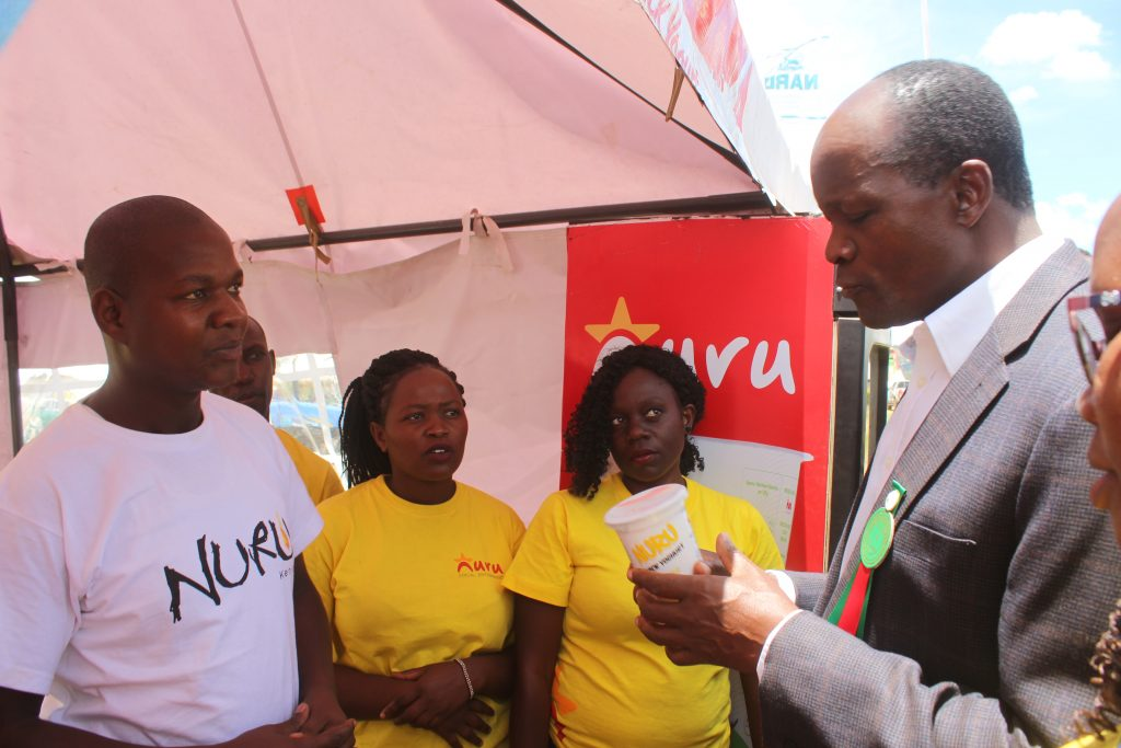 man tasting yogurt in Kenya